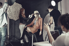 Fashion Stylist With Model At Photoshoot
