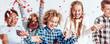 Leinwandbild Motiv Smiling kids playing with confetti