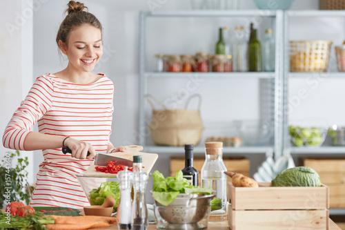 Woman preparing vegetarian meal Wallpaper Mural