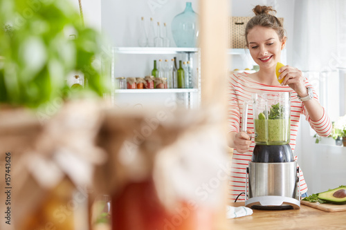 Woman making vegetable smoothie Canvas Print