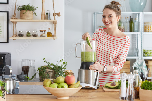 Woman preparing green smothie Canvas Print