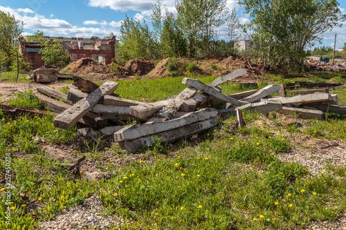 Fotografie, Obraz  Remains of concrete pillars piled into the pile