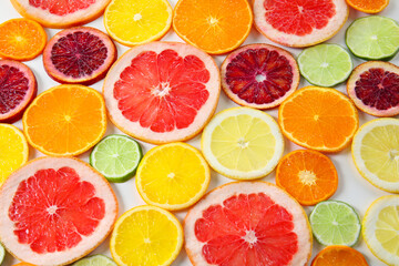 Juicy slices of citrus fruits, closeup