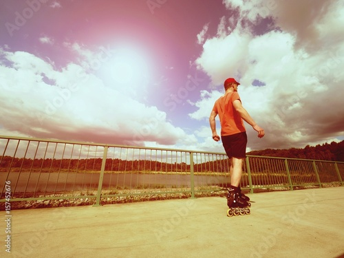 Staande foto Jogging Vintage tone filter effect color style. Sportsman with inline skates ride in summer park