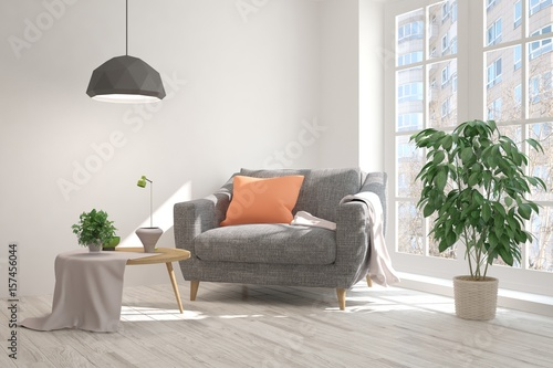 Valokuva  White room with armchair and urban landscape in window