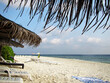 Beach of the island Ukulhas - perfect for relaxing with sunshade and sun lounger at the Maldives
