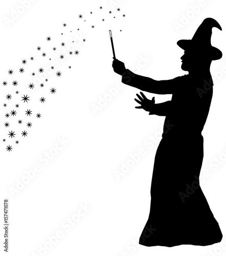 Photo  Silhouette of bearded wizard in cloak with pointed hat creating magic