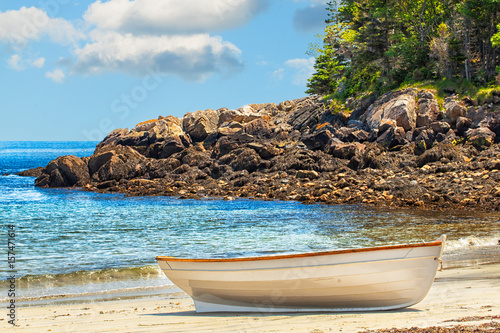 Rowboat pulled onto a sandy island beach off of Maine, USA Canvas Print