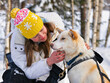 Girl and Husky dog in Lapland in Finland