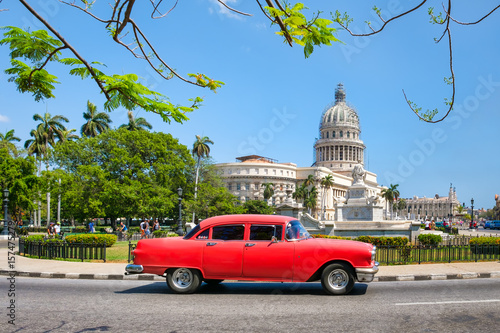 Poster Havana Classic american car next to the Capitol building in Old Havana