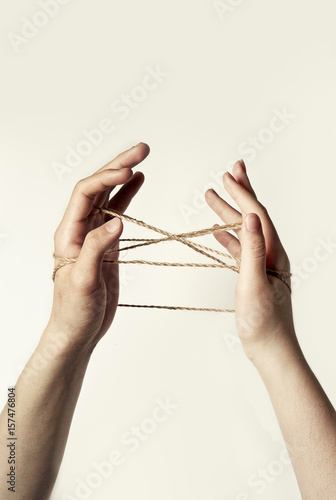 Fototapety, obrazy: hand play with rope isolated white.