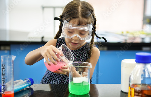 Fotografia  Kindergarten Student Mixing Solution in Science Experiment Laboratory Class