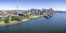 Panoramic_Helicopter_View_of_Seattle_Washington_Waterfront_on_Sunny_Summer_Day_with_Skyline_of_Buidlings