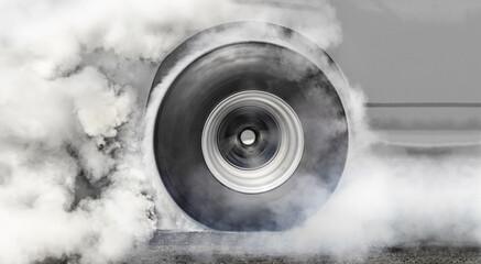 Drag racing car burns tire for the race