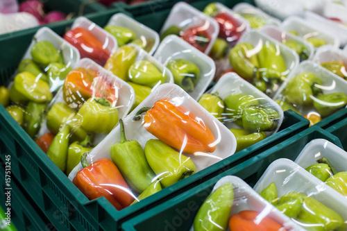 Bulgarian pepper in a box on a shelf in a supermarket