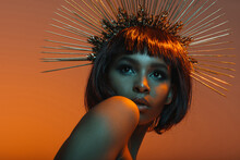 Stylish African American Girl Posing In Headpiece With Needles