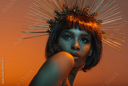 stylish african american girl posing in headpiece with needles Canvas