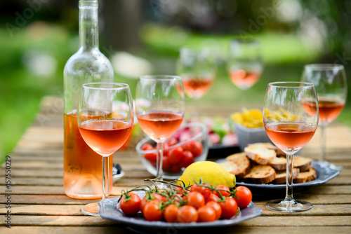 Poster Buffet, Bar holiday summer brunch party table outdoor in a house backyard with appetizer, glass of rosé wine, fresh drink and organic vegetables