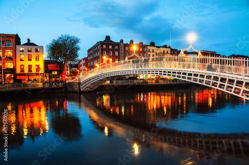 Dublin, Ireland. Night view of famous illuminated Ha Penny Bridge