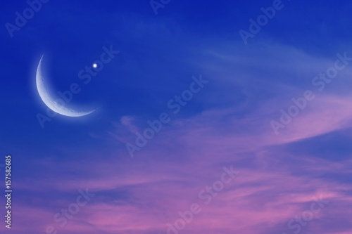 Sunset and new moon . Eid Mubarak background  .  Against the background of clouds . beautiful sky . Nasa  . Sunset and new moon  .  Prayer time  .     peaceful sky for the Muslim