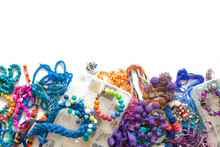 Colorful Beads, Pliers And Bijouterie Lie On A White Background.