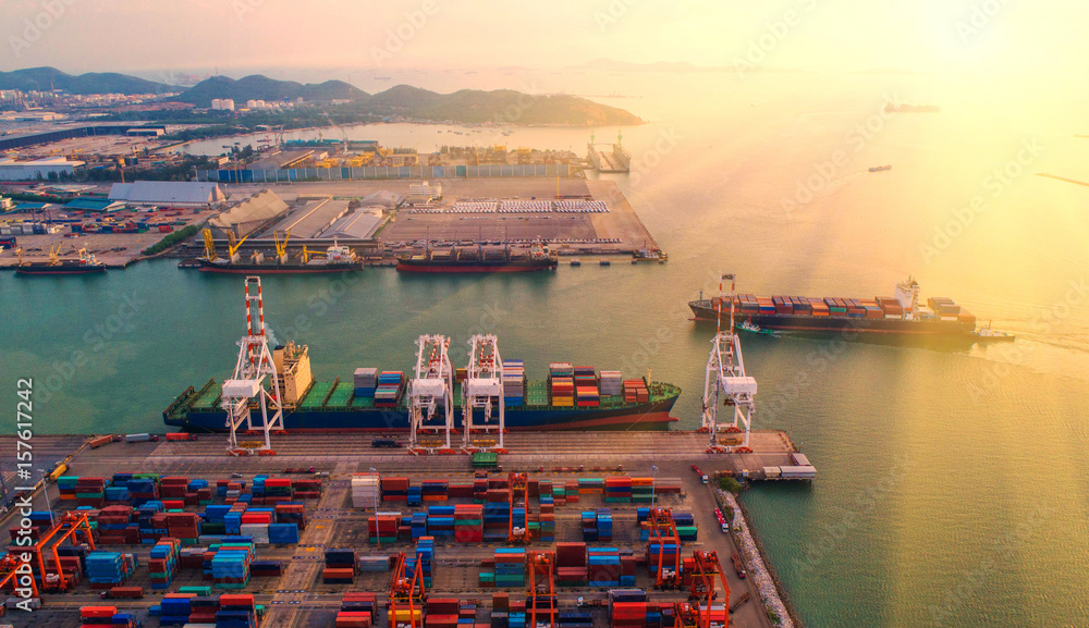 Fototapeta container ship in import export and business logistic.By crane ,Trade Port , Shipping, cargo to harbor, Aerial view, Top view.