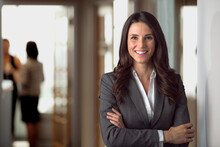 Happy Smiling Ceo Manager At Office Space, Possibly Real Estate, Lawyer, Non-profit, Marketing