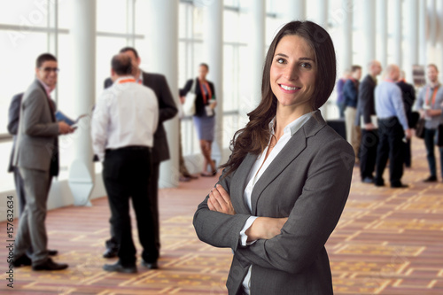 Fotografie, Obraz  Happy business woman standing in crowd at workshop event with big genuine natura