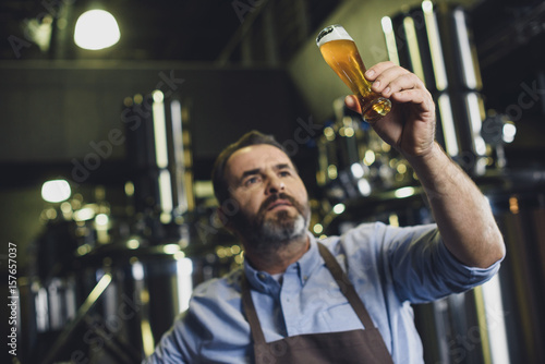 Brewery worker with glass of beer Canvas Print