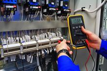Engineer Tests Industrial Elec...