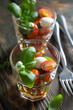 Small caprese salad in a glass