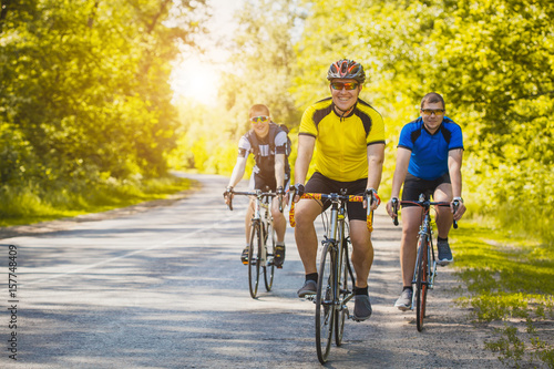 Fotografie, Obraz  bikers on a summer workout on a forest road