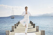 Mediterranean Sea, Fit Fifty, mature man doing yoga on jetty