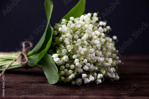 Wall Murals Lily of the valley on wooden background. Lily of the valley bouquet