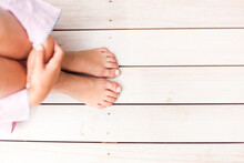 A Child's Bare Feet Poolside