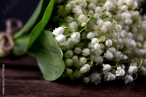 Wall Murals Lily of the valley Lily of the valley on wooden background. Lily of the valley bouquet