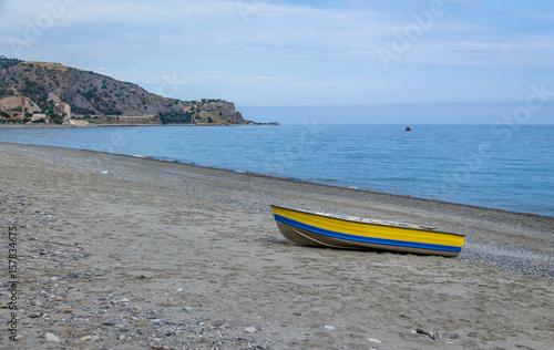 Fototapeta  Blue and Yellow boat in a Mediterranean beach of Ionian Sea - Bova Marina, Calab