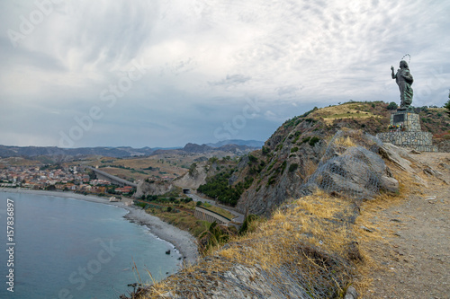 Fotografie, Obraz  Madonna del Mare (Our Lady of the Sea) statue and Bova Marina Town aerial view -