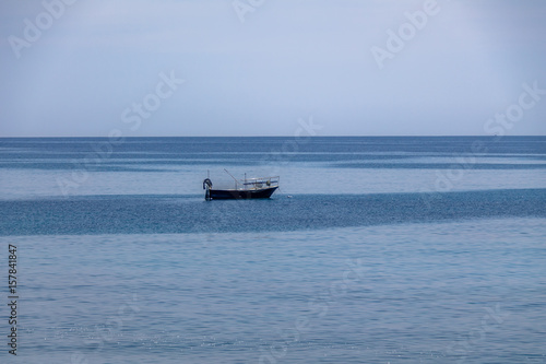 Fotografie, Obraz  A boat in a Mediterranean beach of Ionian Sea - Bova Marina, Calabria, Italy