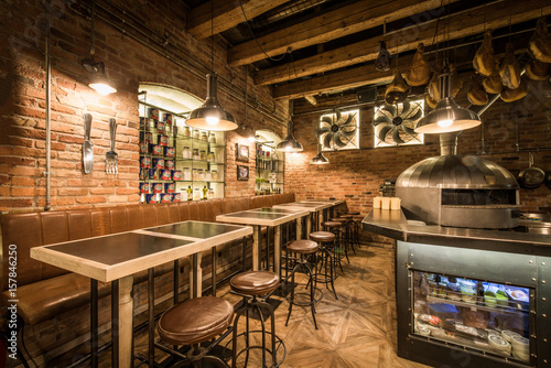 Photo Stands Library Interior of pizza restaurant with wood fired oven