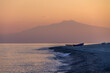 Sunset on a Mediterranean beach of Ionian Sea with Mount Etna Volcano on background - Bova Marina, Calabria, Italy