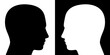 Opposing view - two heads facing each other, one is black on white, the other converse, as a symbol for adverse opinions, contrary ideas, opposite behavior or different beliefs or lifestyle.