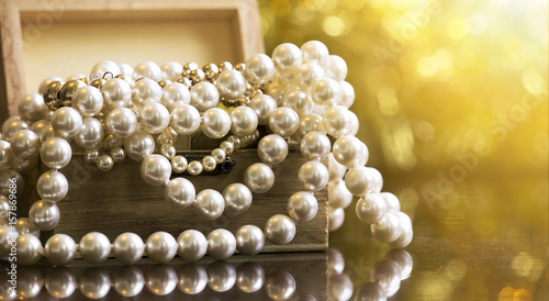 Website banner of white and golden pearls jewelry in a wooden box