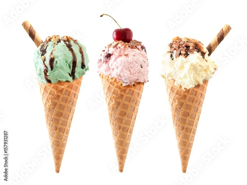 Fotografie, Obraz  Pistachio, cherry and vanilla ice cream with topping in waffle cones isolated on