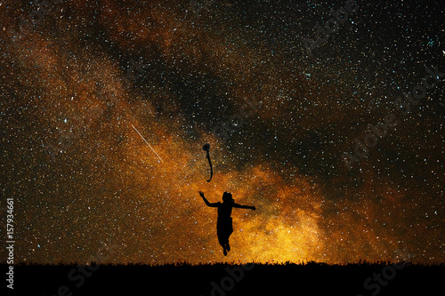 Cuadros en Lienzo Silhouette joyful girl on a background of stars, the concept of joy and happiness