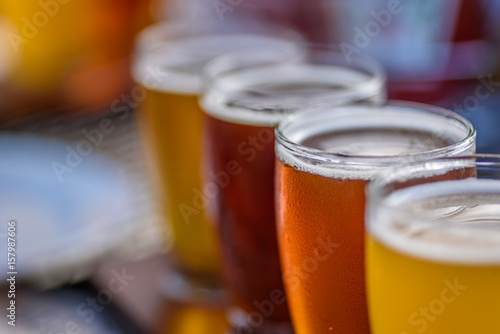 closeup of a beer flight sampler outside at microbrewery in summer sun Canvas Print