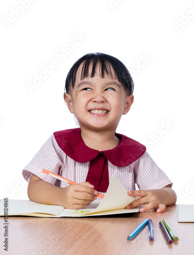 Asian Little Chinese girl drawing with color pencils Wall mural
