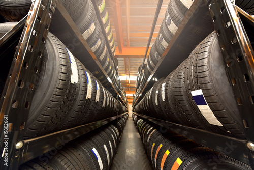 Fotografiet  Tire rubber products , Group of new tires for sale at a tire store