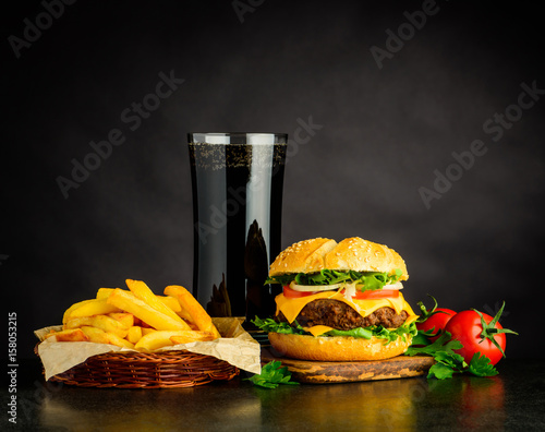 Tasty Looking Cheeseburger with Cola and French Fries Fotobehang