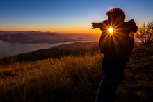 Ilhouette Of A Photographer Like To Travel And Photography, Taking Pictures Of The Beautiful Moments During The Sunset ,sunrise.